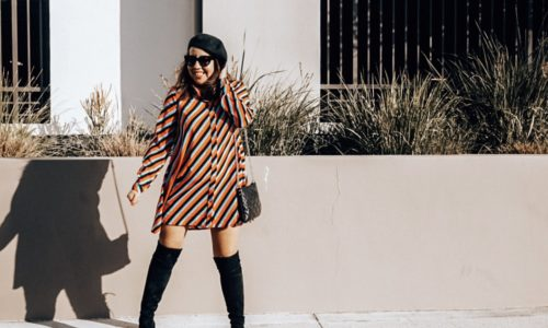 Girl in striped mod dress and beret.