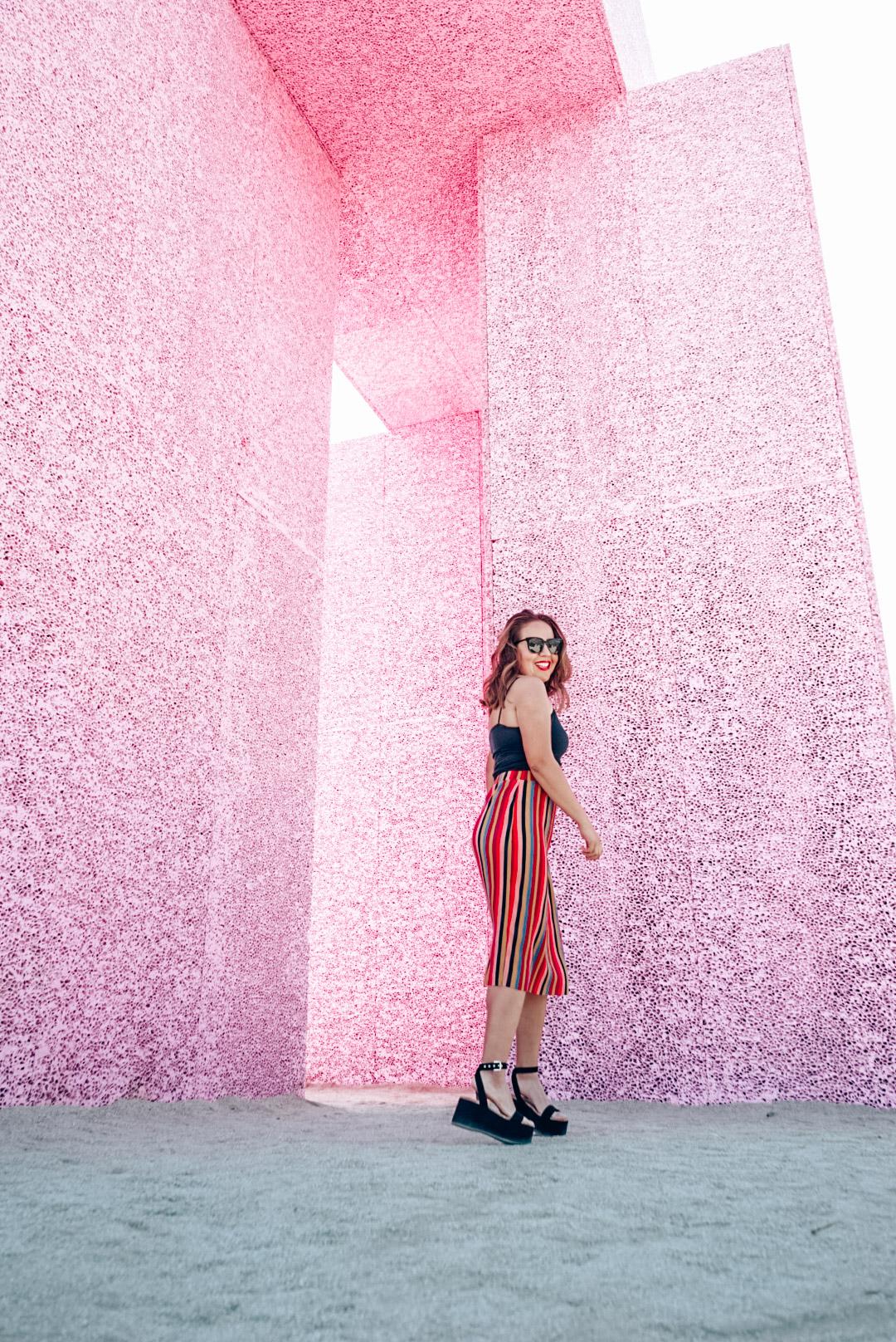 Girl in skirt in front of the Super Flex art exhibit in the Coachella Valley.