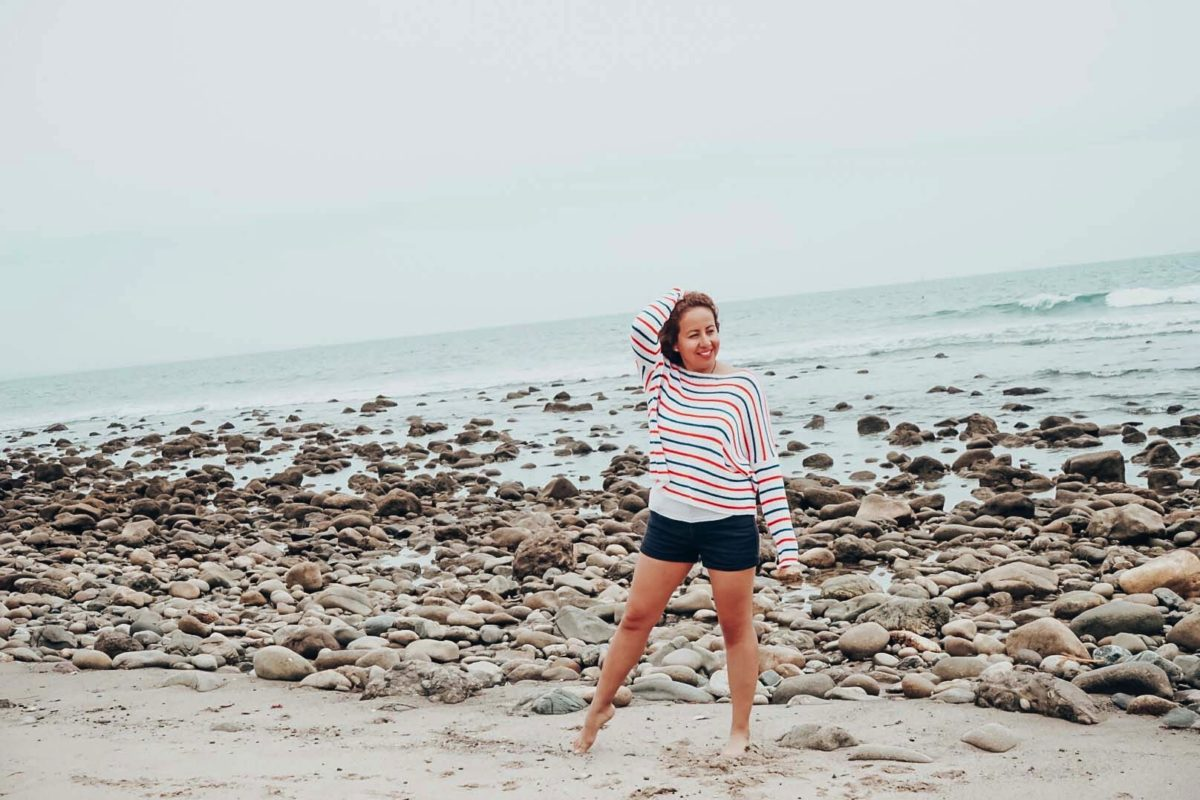 Striped sweater for 4th of July celebrations worn by a girl at the beach.