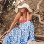Living life with purpose and style. Spending time at the beach, wearing a long tiered skirt with bikini top.