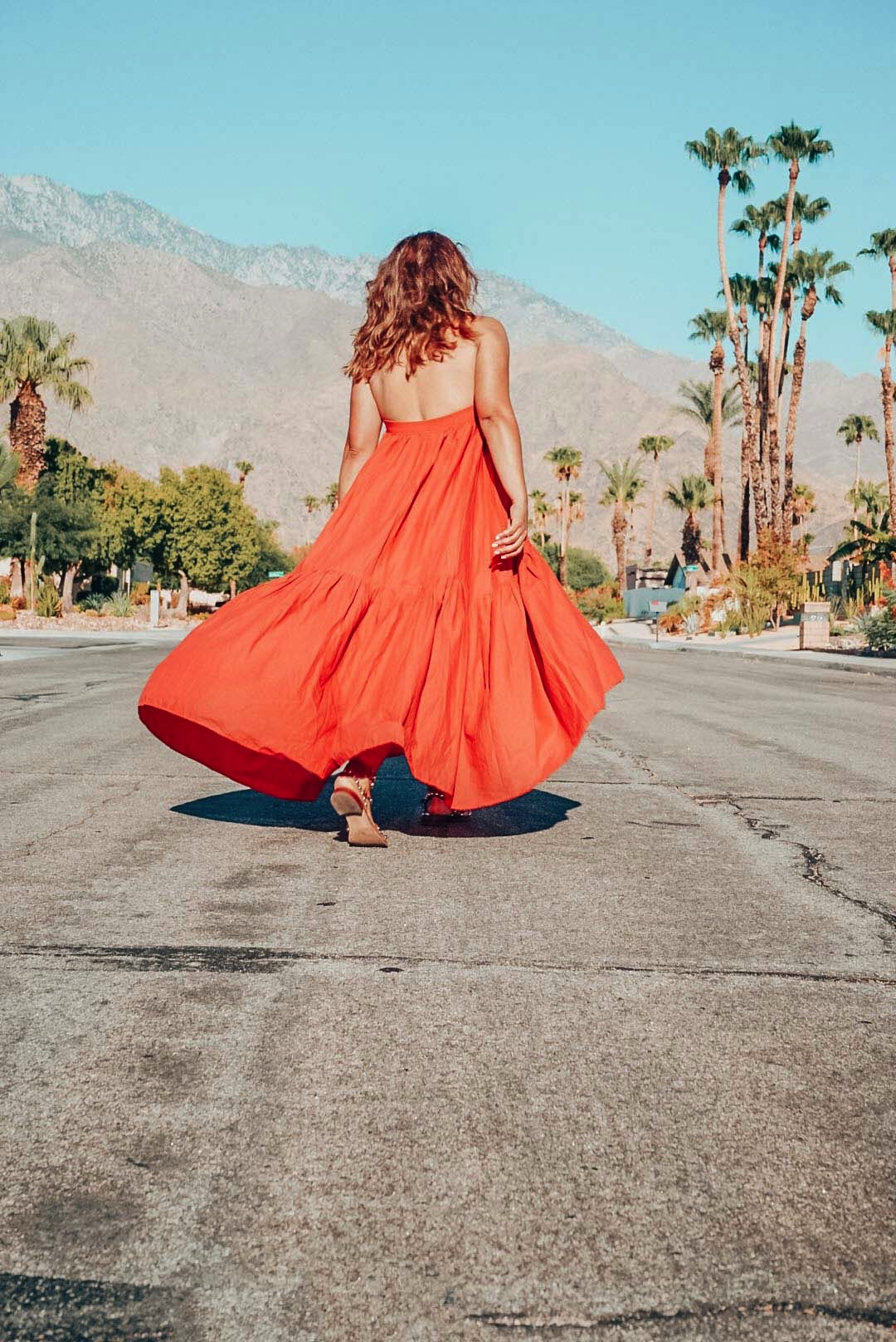 Girl in twirling dress in Palm Springs.
