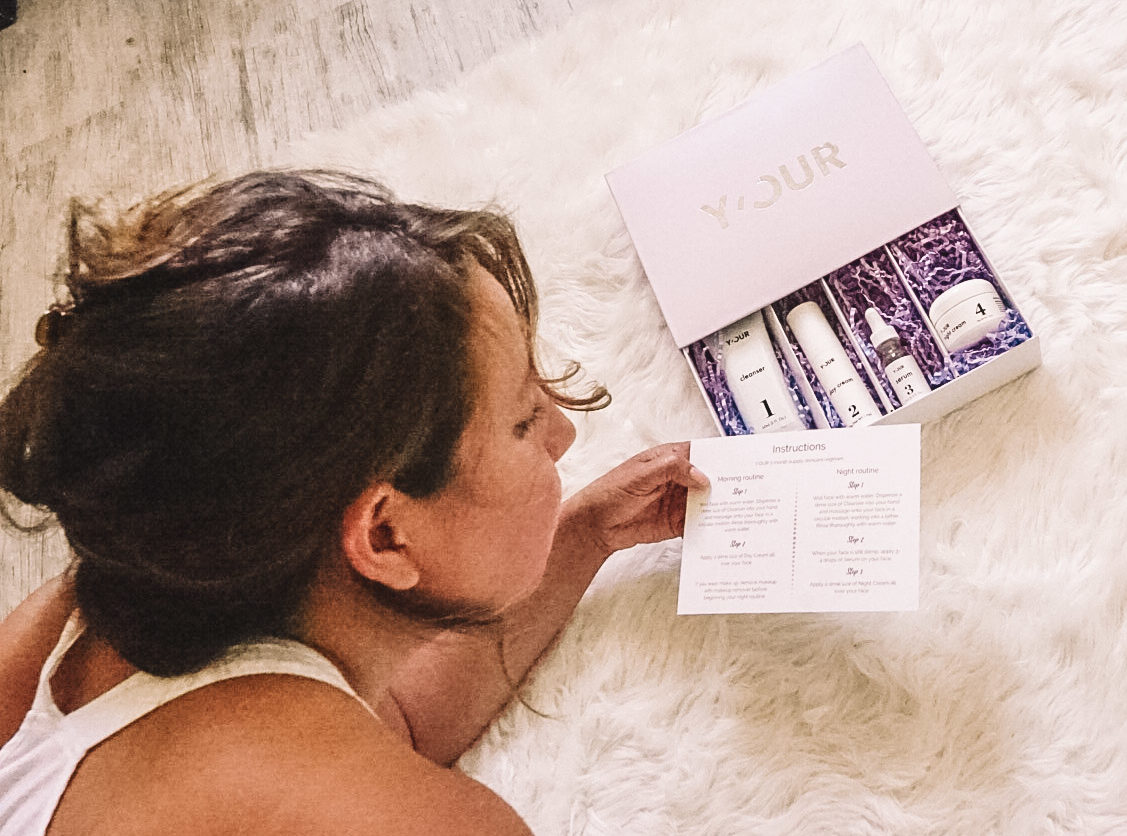Girl looking at directions for the skincare kit.