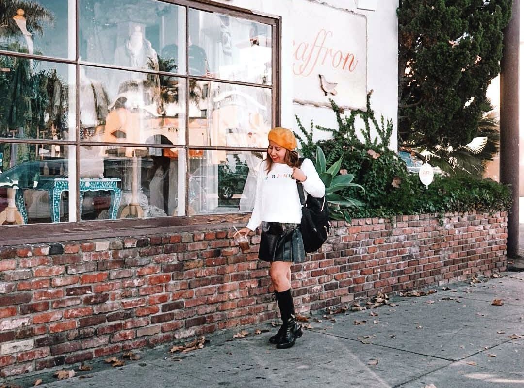 Mini skirt and combat boots style with a Parisian beret.