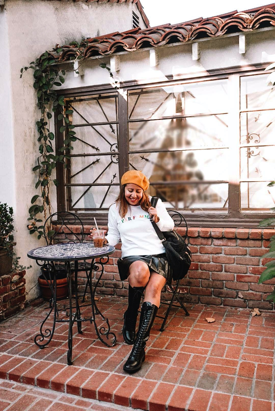High combat boots and a Parisian style with yellow beret.